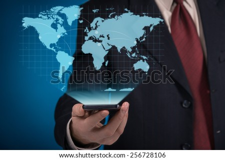 Businessman using virtual screen with world map - stock photo