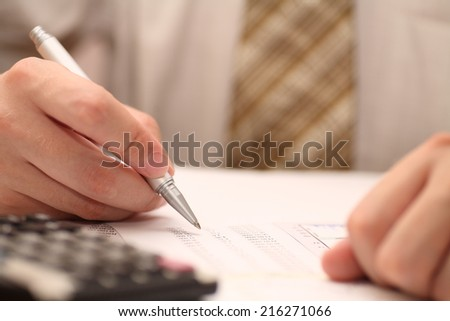 Businessman viewing financial statements.