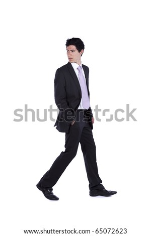 Businessman walking and looking back isolated on white (some motion blur) - stock photo