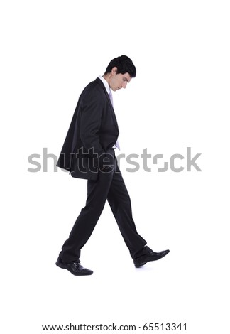 Businessman walking and looking down isolated on white (some motion blur) - stock photo
