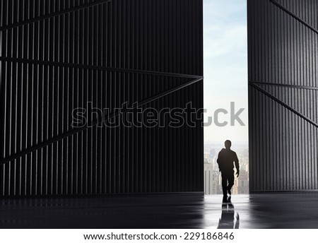businessman walking and open doors to city - stock photo
