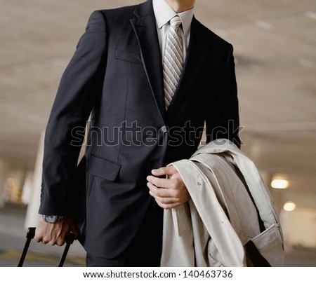 businessman walking in airport - stock photo