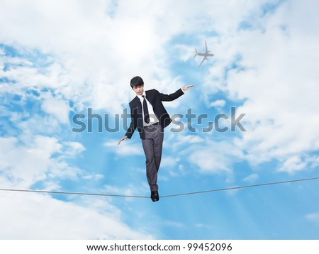 Businessman walking on rope - stock photo