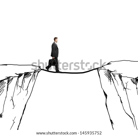businessman walking on rope from rock to rock - stock photo