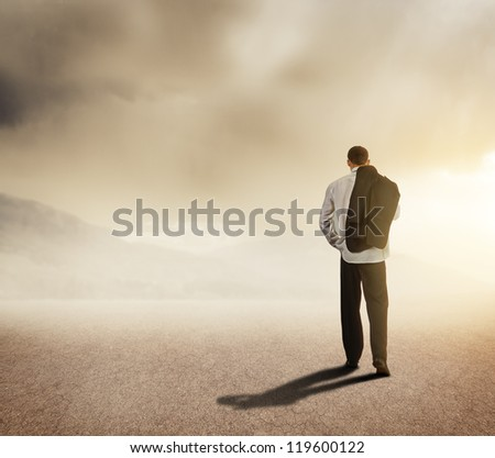Businessman walking on the road - stock photo