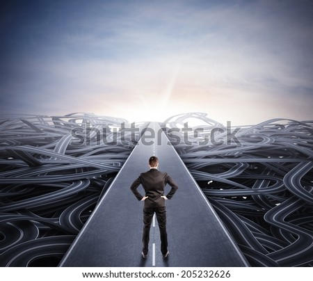 Businessman walking the easy way to success - stock photo