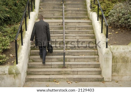 businessman walking up stairs - stock photo