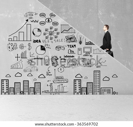 businessman walking up stairs and business concept on wall - stock photo