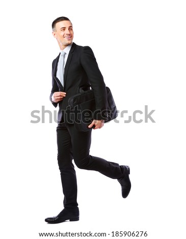 Businessman walking with laptop bag isolated on a white background - stock photo