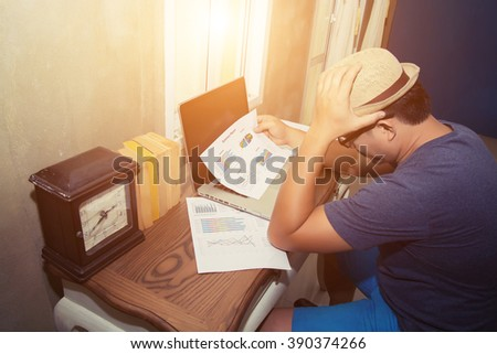 Businessman watching at analysis chart look so serious