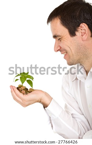 Businessman watching his investment growing - isolated - stock photo