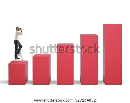 Businessman watching with binoculars the highest step