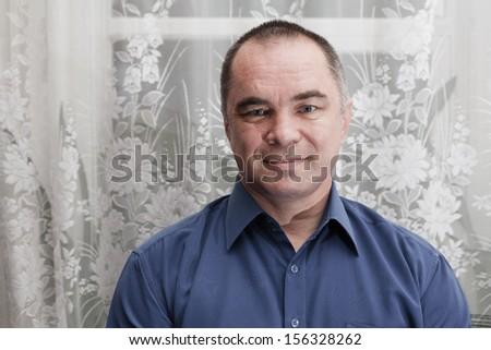 businessman weared blue shirt, mid age man, indoors, looking away , horizontal shot, looking at camera, toned image - stock photo