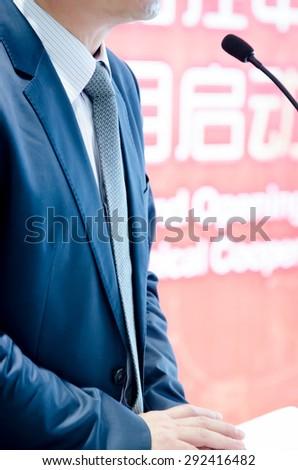Businessman wearing a  blue necktie - stock photo
