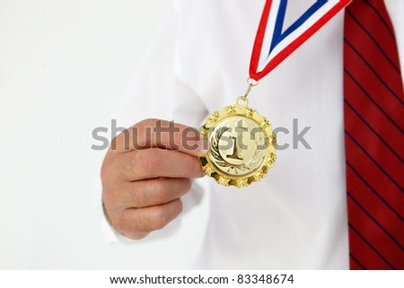Businessman wearing medal - stock photo