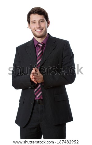 Businessman wearing suit and tie clapping in his hands