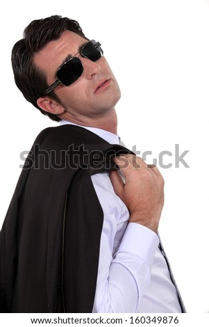 Businessman wearing sunglasses - stock photo