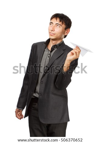 Businessman whit paper planes on white background. Concept of startup.