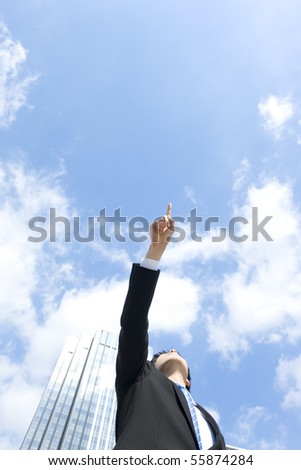 Businessman who points in the sky