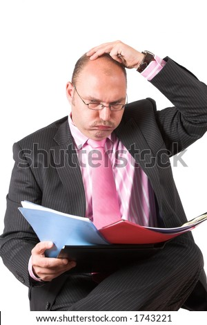Businessman who really has no idea how he can make any order in the chaos - stock photo