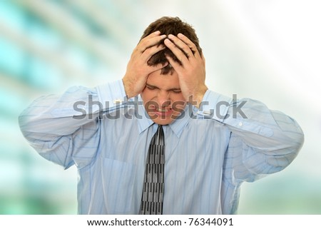 Businessman with a big headache - stock photo