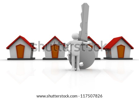 Businessman with a big  key in his hand next to a houses - stock photo