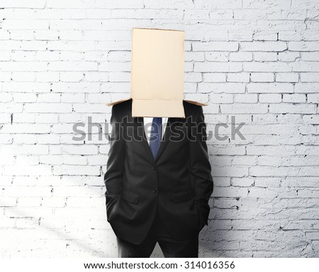 businessman with a box on head - stock photo
