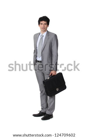 Businessman with a briefcase - stock photo