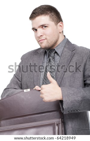 businessman with a briefcase and with thumb up - stock photo