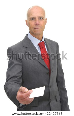 Businessman with a business card isolated against a white background