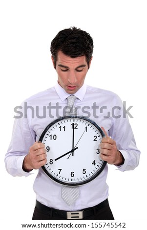 Businessman with a clock - stock photo
