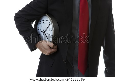 Businessman with a clock under his arm as if he is running with it. - stock photo