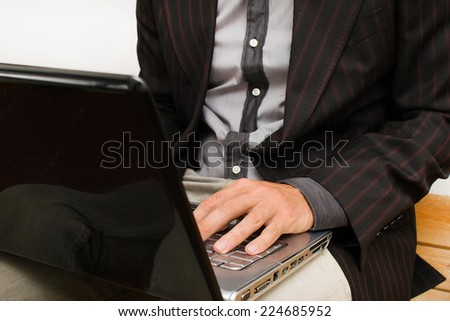 Businessman with a computer  - stock photo