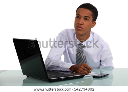 Businessman with a dreamy face - stock photo