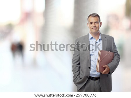 businessman with a folder in the city - stock photo