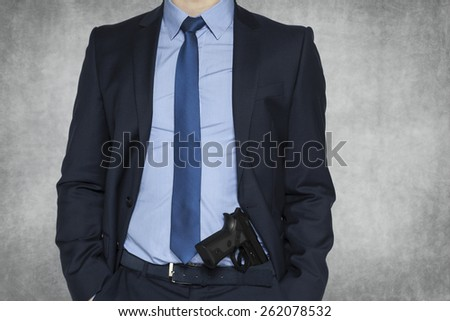 businessman with a gun for protection - stock photo