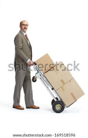Businessman with a handcart on a white background - stock photo