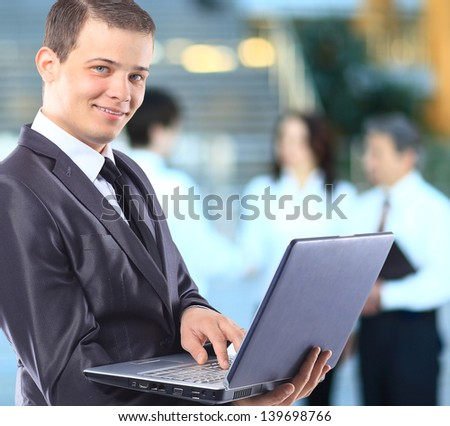 Businessman with a laptop.
