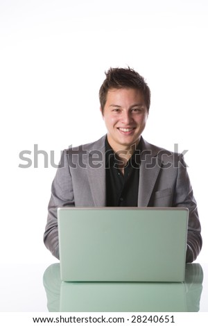 Businessman with a laptop computer isolated against white background