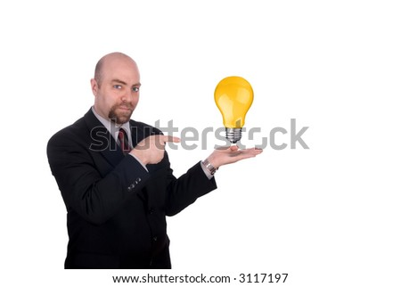 Businessman with a lightbulb in his open hand isolated on white - stock photo