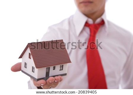businessman with a mini house for real estate concept presentation - stock photo