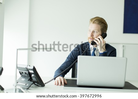 Businessman with a phone in the office