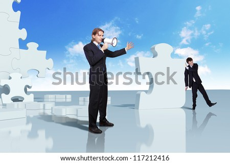 Businessman with a puzzle pieces on the background