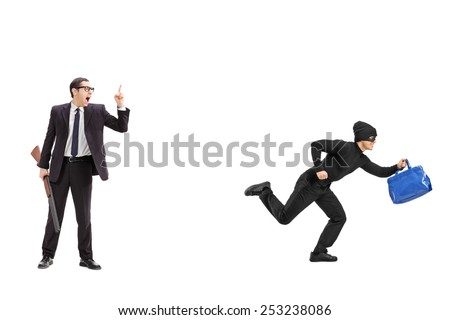 Businessman with a rifle chasing a thief isolated on white background - stock photo