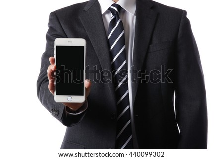 Businessman with a Smartphone - stock photo