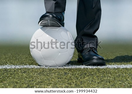 Businessman with a soccer ball  - stock photo