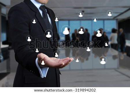 Businessman with a social network. - stock photo