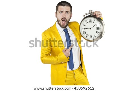 businessman with a strange expression indicates the clock