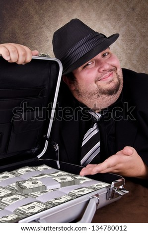 Businessman with a suitcase full of cash, on white background. - stock photo