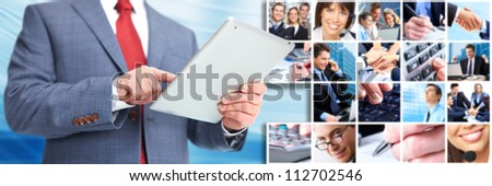 Businessman with a tablet computer. Business techno background.